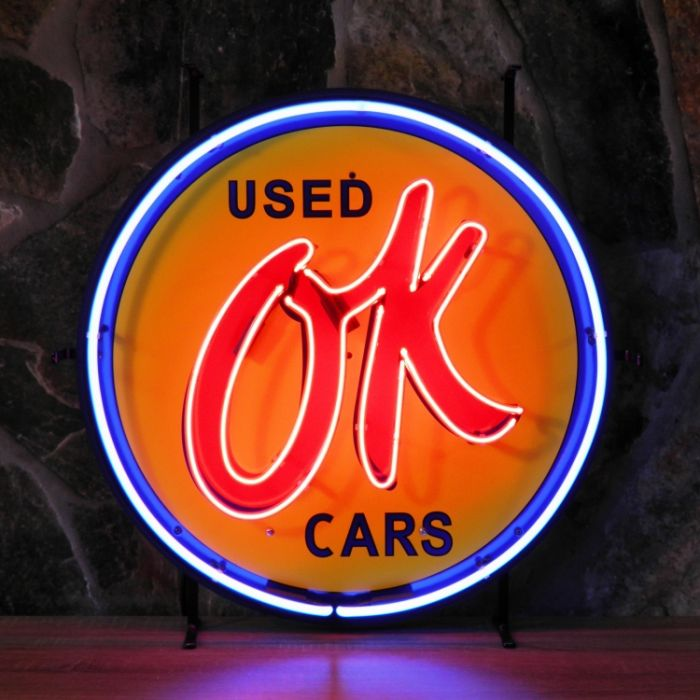 OK Used Cars neon with background